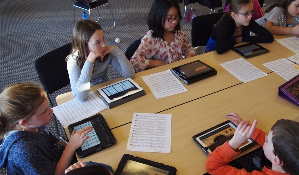 Students using tablet at school